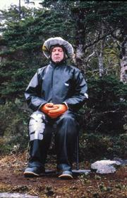 Bob Kull meditates in the rain during his year-long retreat in the Patagonia wilderness.