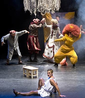Onise Oniani as Puck (foreground) with the cast of the Pyramus and Thisbe sequence from Marjanishvili's production of A Midsummer Night's Dream.
