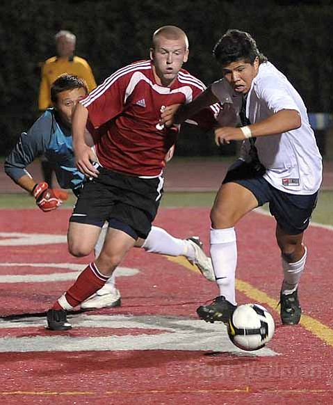 Pictured here in the Western State Conference opener against L.A. Mission in September, SBCC's Mark Knight (center) has gone on to score 18 goals in 16 games this season.