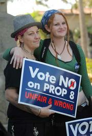 Crystal Harris (left) and partner Devin Barry, who engaged to be married, attend the No on Prop 8 rally at the courthouse