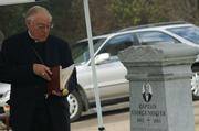 Bishop Thomas Curry blesses George Nidever's recently discovered grave.