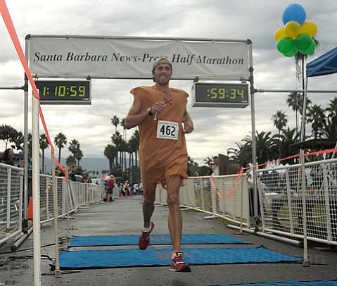 Aaron Gillen flies across the finish line of the 32nd <em>Santa Barbara News-Press</em> Half Marathon.