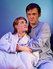 Christy Escobar as Rachel and Merlin Huff as Tom.