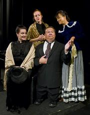 Leslie Story, Stephanie Sivers, and Deborah Helm surround Ed Giron as the town judge in Edgar Lee Masters's <em>Spoon River Anthology</em>.