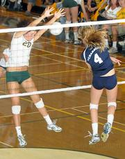 Dos Pueblos High's Samantha Wopat (#4) powers a spike past Madison Hamilton (#20) of Santa Barbara in last week's Channel League volleyball championship match. Dos Pueblos won in five games, and both teams advanced to the CIF playoffs.