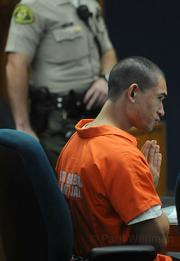 Edward Kyle Van Tassel listens with praying hands at his arraignment and bail hearing in November.