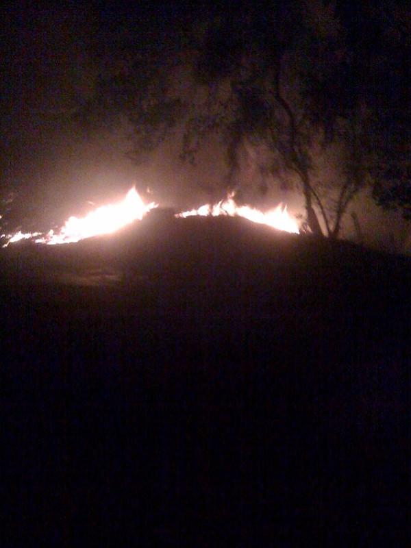 The fire peeking over a ridge, now the Riviera is ablaze.