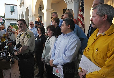 Santa Barbara County Sheriff Bill Brown (left), with other local dignitaries, address the media at City Hall with updates on the Tea Fire.