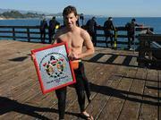 Santa Barbara Countys Aquatics Coordinator and Lifeguard Supervisor  Jon Menzies holds a placque from the Asociacion de Bomberos del Estado de Baja California