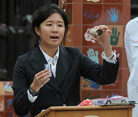 "Jennifer Kim of CalPIRG warns ""the buyer to beware of hidden toy hazards"" such as unsafe lead content and high concentrations of phthalates during a press conference at Kid's World in Santa Barbara."
