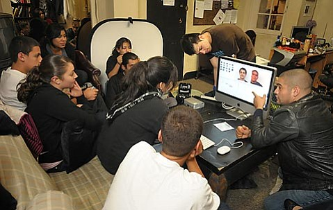 Youth CineMedia founder Osiris Casta±eda (right) teaches a group of high-risk teenagers about shooting and editing videos. The training is fun, gives the kids professional skills, and keeps many of them from entering the gang life.