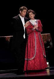 Robert Yacko and Carolyn Hennesy as Mr. and Mrs. Darling.