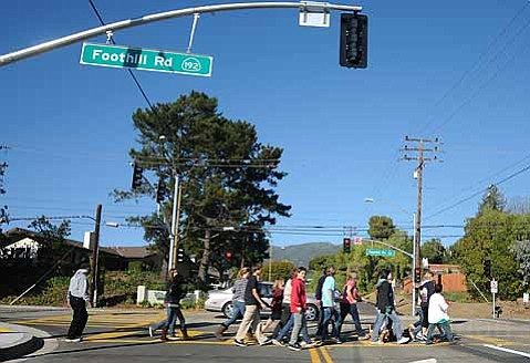 La Colina students return to campus after the press conference announcing the new traffic signal Foothill and Cieneguitas Roads.