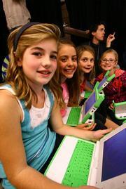 Kids enjoying their new laptops.