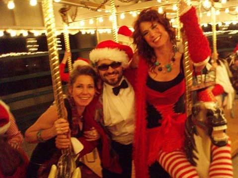 Elvi Morris, Devin Zahn and Sue Axelband enjoy the carousel as part of Santacon 2008. Photo credit Sue Axelband.