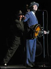 Scotty Morris (right) led Ventura's Big Bad Voodoo Daddy through a set full of Christmas tunes, swing standards, and original compositions last Tuesday night at the Arlington Theatre.