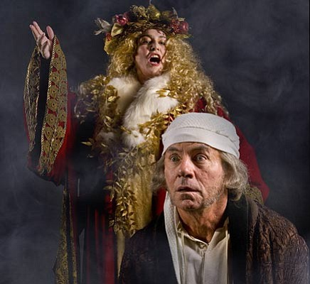 Susan Kelejian as the Ghost of Christmas Present looks over the shoulder of James Sutorius as Scrooge in<em> A Christmas Carol</em>.