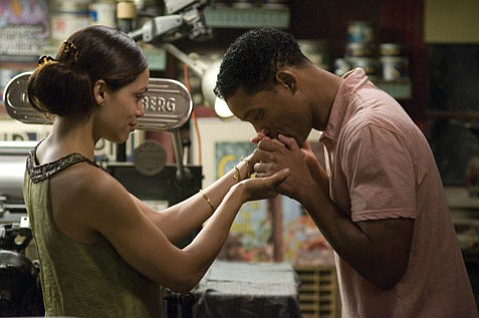 Rosario Dawson and Will Smith are caught in a complicated romance in <em>Seven Pounds</em>.