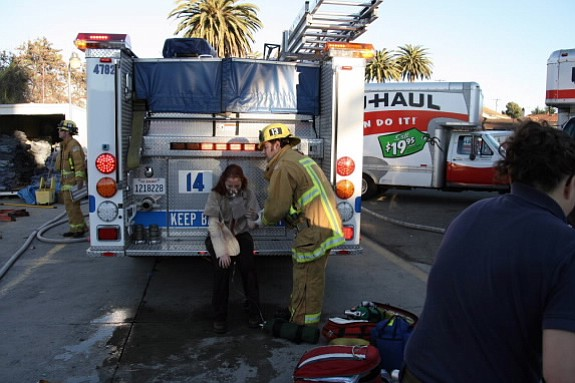 A woman recovers from the December 29 blast at the U-Haul rental facility in Goleta.