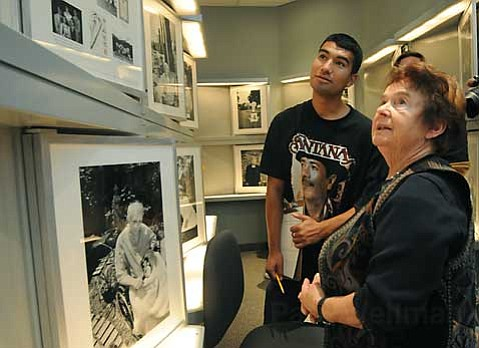 Holocaust survivor Maria Segal (right) tells her history to Community Day School instructional aide Arturo Lopez