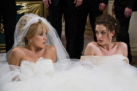 Instead of centering on the couple, love, and commitment, why not make marriage about competition and female stereotypes? Liv (Kate Hudson) and Emma (Anne Hathaway) battle in <em>Bride Wars</em>.