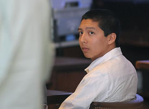 Ricardo Juarez, at his sentencing for the voluntary manslaughter of Luis Angel Linares in 2007, shows no emotion as he listens to the testimony of Humberto Linares, the victim's father.