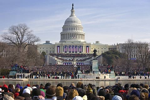 """America the Beautiful"":  People crammed together behind the Reflecting Pool to watch the historic inauguration of the nation's 44th president, Barack Obama, on Tuesday, January 20."