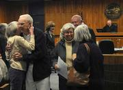 James Wheeler gets hugs from joyful friends and family after being released on probation at his sentencing. Wheeler attempted to kill his dementia-stricken wife and himself in September 2008 to prevent their separation.