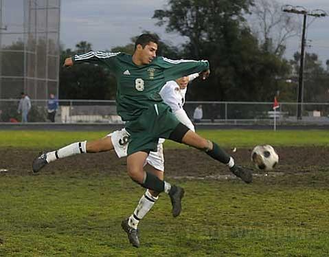 Santa Barbara Don Jesse Gonzalez (foreground) goes up against Dos Pueblos Charger Rodrigo Perez.