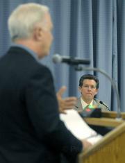 Goleta City manager Dan Singer (center) listens to Steven Amerikaner, attorney for Goleta West, (left) addressing the Goleta City Council