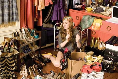 Isla Fisher stars as the afflicted in <em>Confessions of a Shopaholic</em>.