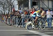 Lance Armstrong flies by screaming fans at the start of the AMGEN time trials in Solvang, CA
