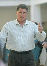 Wayne Scoles, found not guilty on two counts of disturbing the peace, leaves the courthouse with a thumbs up