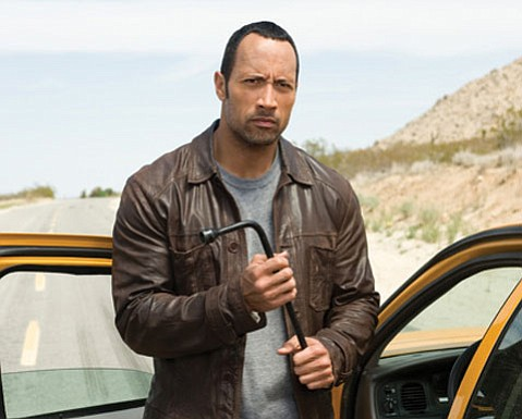 Dwayne (the Rock) Johnson is Jack Bruno, a Vegas cab driver, in <em>Race to Witch Mountain</em>.