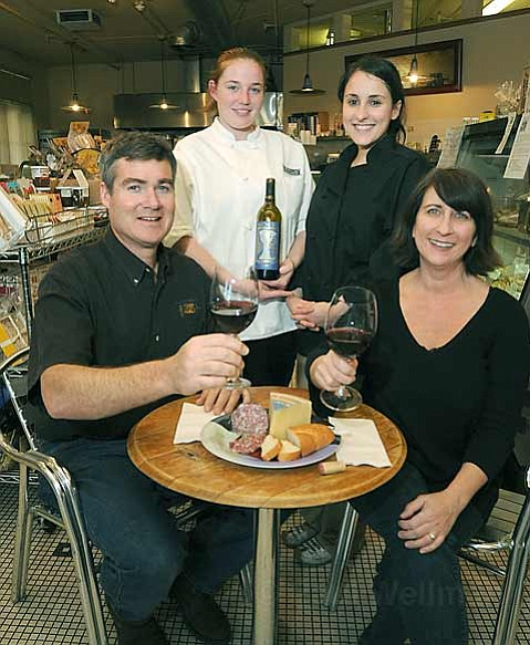 Metropulos owners Craig and Ann Addis (seated) with Jessa Elsasser and Rosa Allouche (standing).