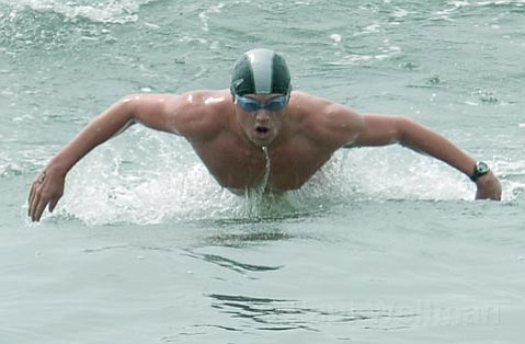 Frank Reynolds (pictured) finished the 1,000 meter swim around the pier in under 15 minutes