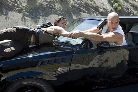 Michelle Rodriguez is Letty, and Vin Diesel is Dominic Toretto, and again they are <em>Fast & Furious</em>.