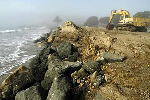 <strong>PERMEABLE PROPOSAL:</strong>  The county is suggesting a new solution for Goleta Beach. Pictured above is maintenance work being done in January 2003 to the previous beach erosion fix, a rock wall.