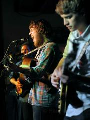 Frontman Robin Pecknold (center) showed off his lauded vocal chops to a sold-out crowd during Monday night's Fleet Foxes show at UCSB's Hub.