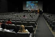 The public and panelists in the Isla Vista Theatre discuss the effects of Floatopia