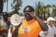 Ugandan Charlie C. Lakony speaks to the group before the march to SBCC