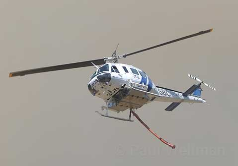 A helicopter making a drop on the Jesusita Fire.