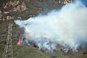 Helicopter drops water along Jesusita Trail where the fire started just before 2PM.