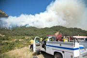 Engine crews watch helplessly as fire begins to spread rapidly towards Inspiration Point.