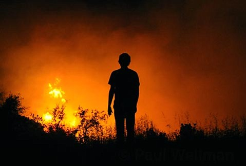 A reporter watches the Jesusita Fire progression on Wednesday night May 6, 2009.