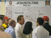 Governor Schwarzenegger gets briefed on the Jesusita Fire at Earl Warren Showgrounds