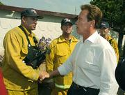Governor Schwarzenegger takes time before a press conference on the Jesusita Fire to shake a few hands of the fire fighters from Cal Fire