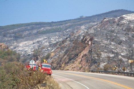 Engine crew from Smartsville CA begin to assess hot spots above Highway 154.
