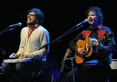 Jemaine Clement (left) and Bret McKenzie belt out one of many hilarious songs during their set at the Bowl last Friday.