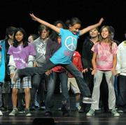 Students from Solvang Elementary and Cesar Ch¡vez Charter School rehearse at the Marjorie Luke Theatre.